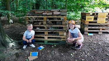 bug hotel and young people at how hill