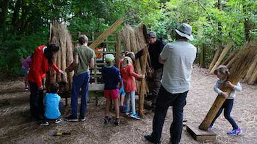 family enjoying a thatching workshop at how hill